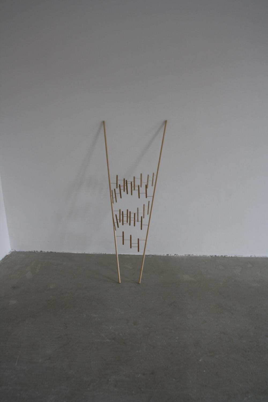 19. Tomáš Hlavina   Zavinovačka   2009, dřevo, bambus   122 x 50 x 16 cm