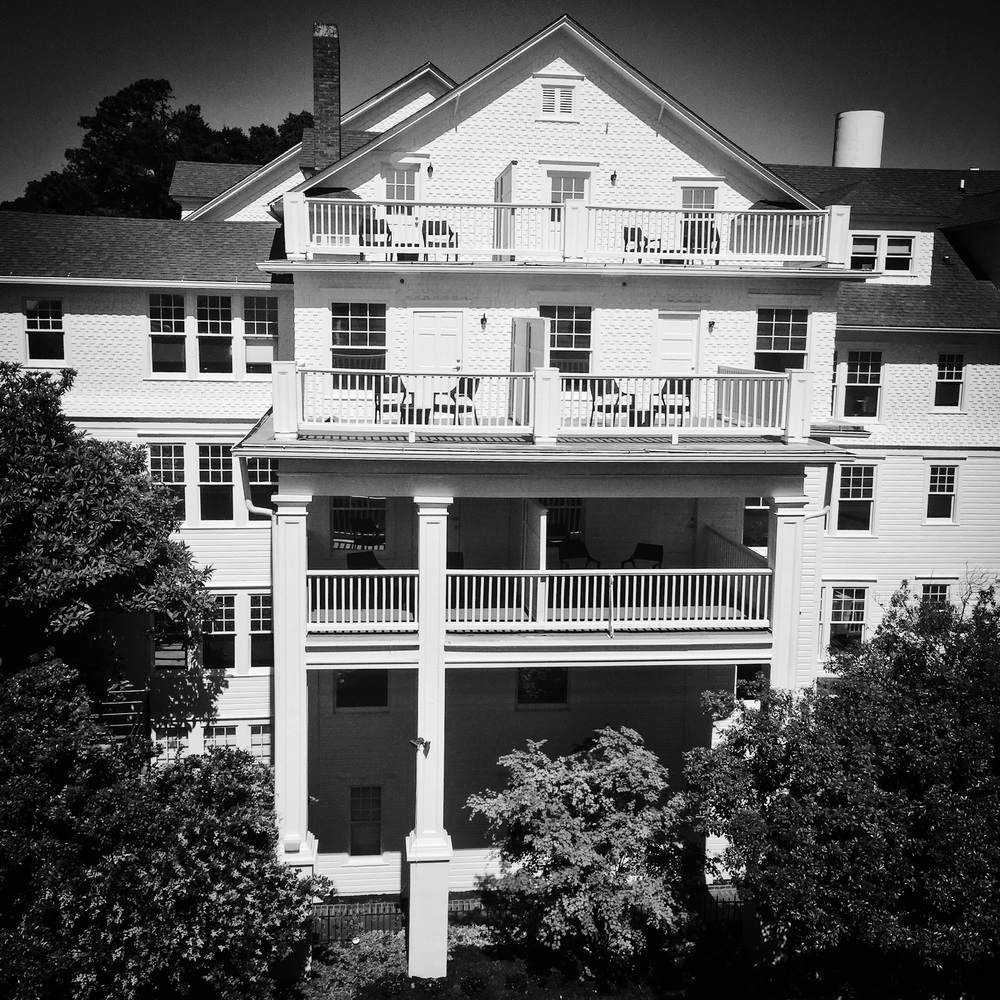 The faćade of the historic and legendary Partridge Inn located in Augusta, Georgia. P hotographed by Dominique James with the iPhone 6 Plus. Post-processing and B&W conversion with PS Express app on the iPhone. Copyright © 2015. All rights reserved. To see more photographs, please visit the Dominique James Phitography website at www.dominiquejames.com.