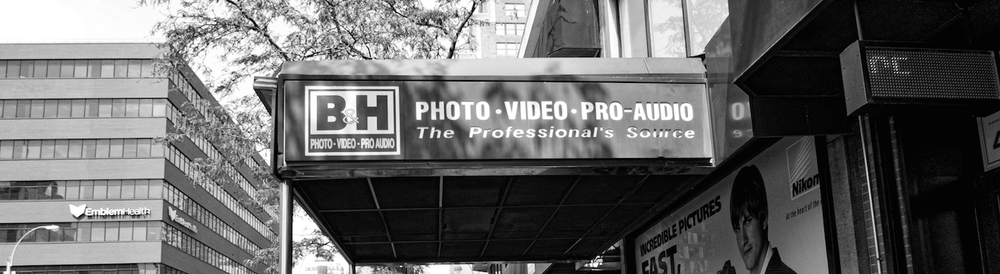 A familiar signage prominently printed on the awning of the main entrance of B&H Photo Video Superstore in Manhattan, New York City. Photo by Dominique James. Copyright @ 2015. All rights reserved.