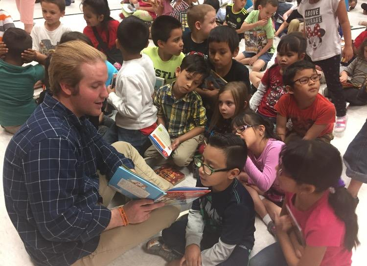That's me! (Zack) reading to kids at Lincoln Elementary in SLC, UT at this year's Pop Open A Good Book event!