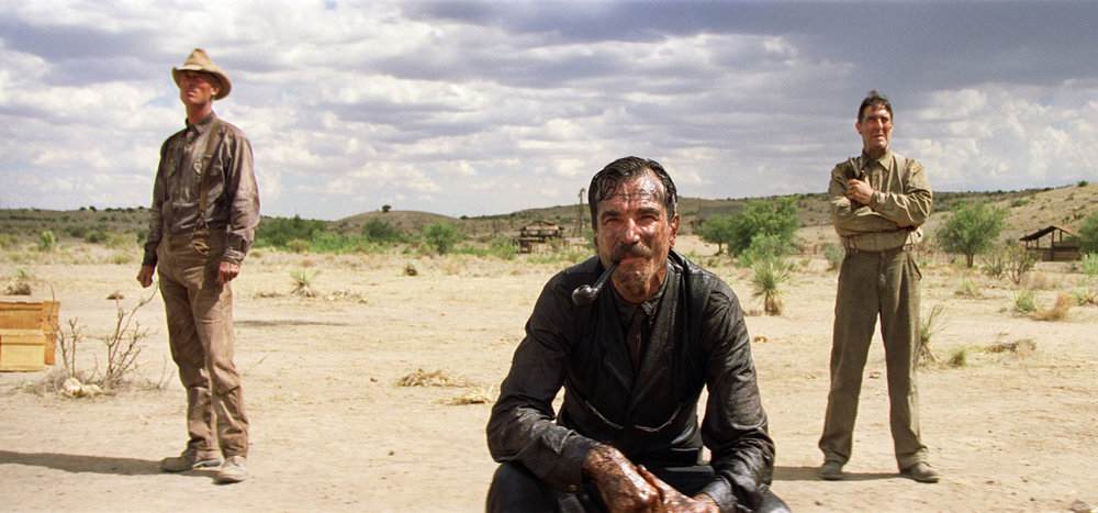"TLR: ""There Will Be Blood"" tackles issues of ambition, and its potential toxicity led by Daniel Day-Lewis' all-time best performance. In terms of backdrop, this is perhaps the most beautiful film on the Op-Rob Top 50."