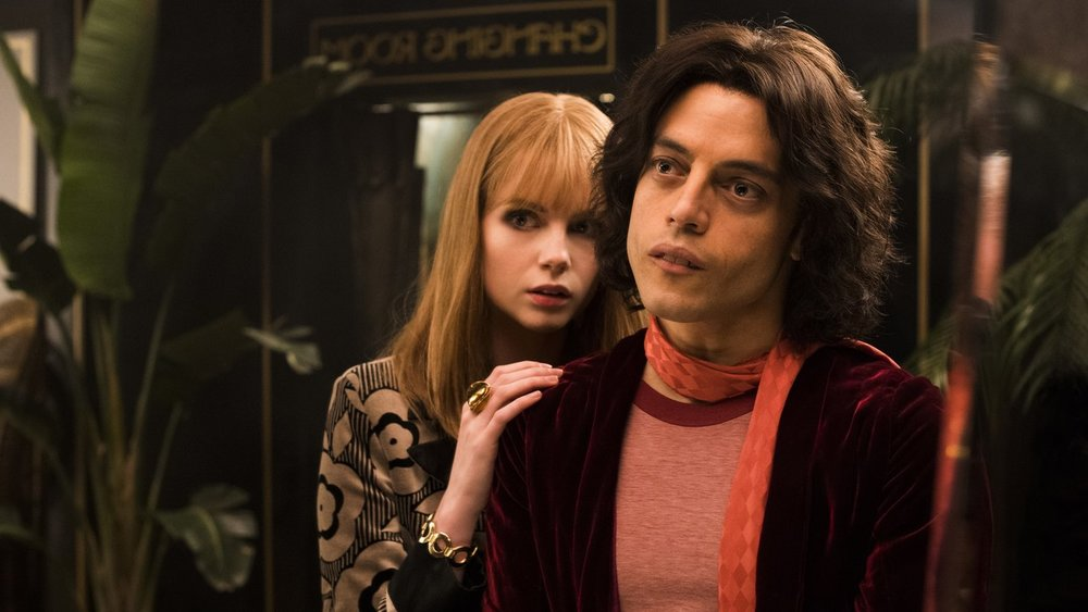 """As overhyped as """"Bohemian Rhapsody"""" was, I have to admit that I enjoyed the film as an entertaining drawn-out music video. Rami Malek is superb as Freddie Mercury, and there is an undeniable pep to each live-music scene. However, when it comes to the more daunting questions surrounding the rise and fall of Mercury, the film completely flops. We never understand Mercury's strained relationship with his family, beyond a few scenes where it is clear they disapprove of his lifestyle. We never understand why Mercury fell in love with Jim Patton (Aaron McCusker), his eventual long time partner. And we never get a real sense of how Queen managed to make the music that made them an all-time great beyond sporadic scenes in which Mercury has an epiphany and starts belting out a hit song. The film operates as a simple showcase for Queen's music, which serves as ample entertainment, but forgettable storytelling."""