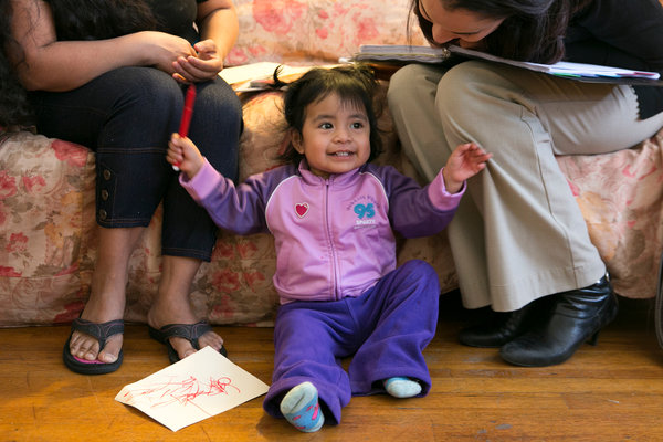 Deisy Ixcuna-Gonzalez, 16 months old, is in a new literacy development program in Providence, R.I.  (Photography: Katherine Taylor for the NYT)