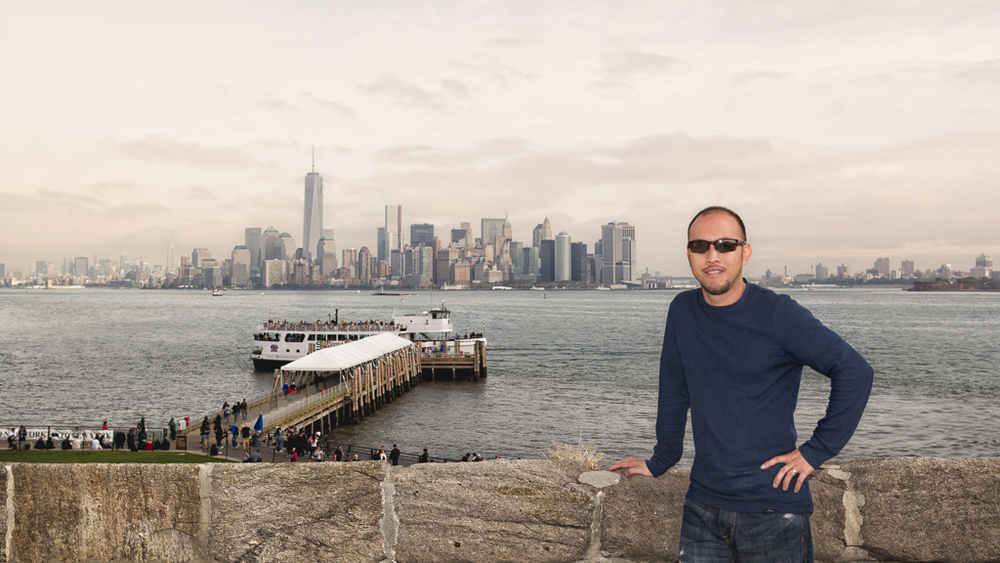 This picture was taken during our trip to NYC, I am standing at the Liberty Island. The far back is Manhattan.