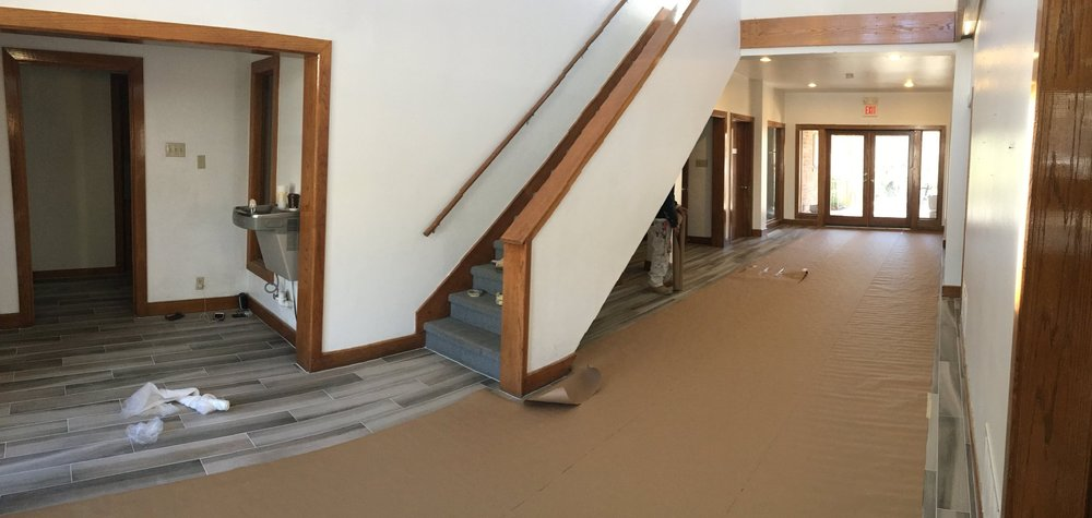 The new ceramic tile is covered while the ceiling is being painted. The trim will be next.