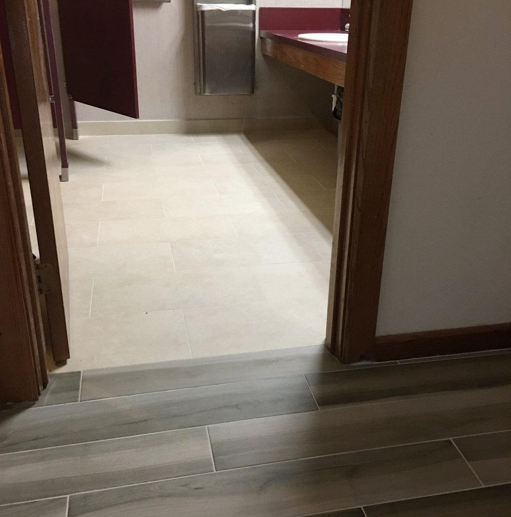 """New 12"""" x 24"""" bathroom tile complements the lobby tile."""