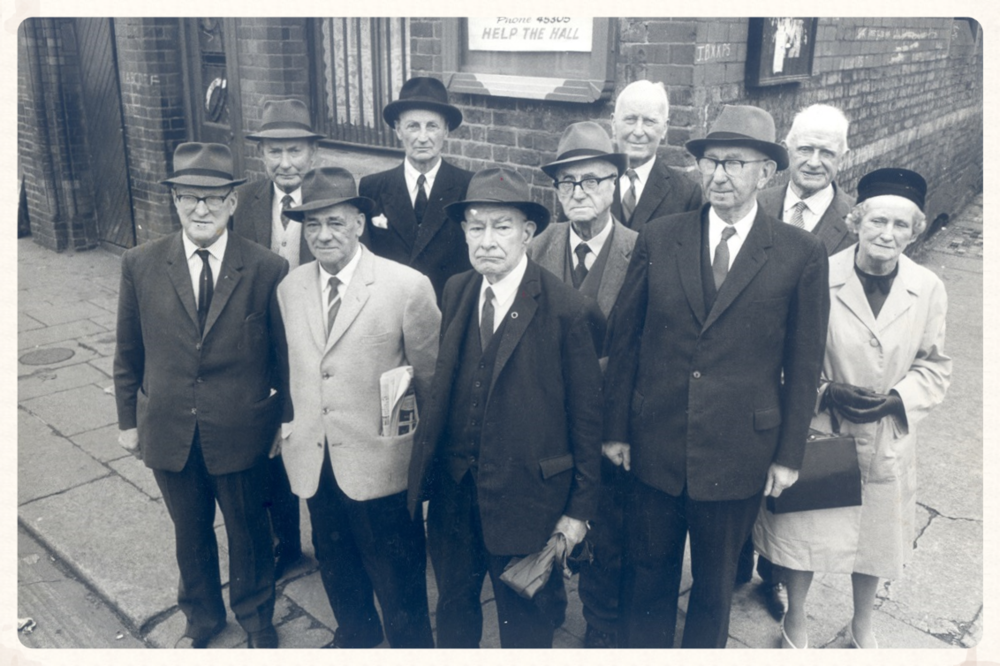 Survivors of the 1st Battalion together again outside Father Matthew Hall in 1964. L-R; Tom Sheerin, Frank Shouldice, Maurice Collins, Eamon Morkan (back row), John S. O'Connor, Mark Flanagan, Piaras Béaslaí, Jack Shouldice, Fionan Lynch, Phyllis Morkan.