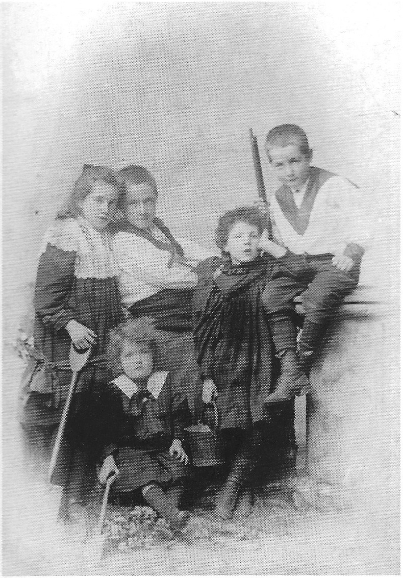Kathleen Boland (left) with her siblings, including Harry (right)