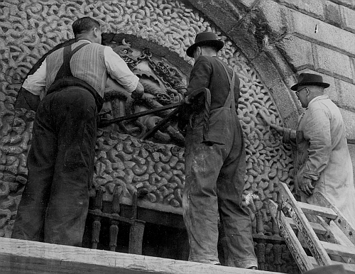 Volunteers working to restore the relief above the entrance to Kilmainham Gaol