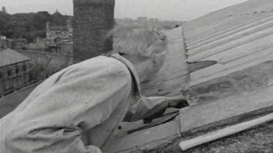 Volunteer Seán Dowling placing the final slate on the restored roof of Kilmainham Gaol's main hall (1964)