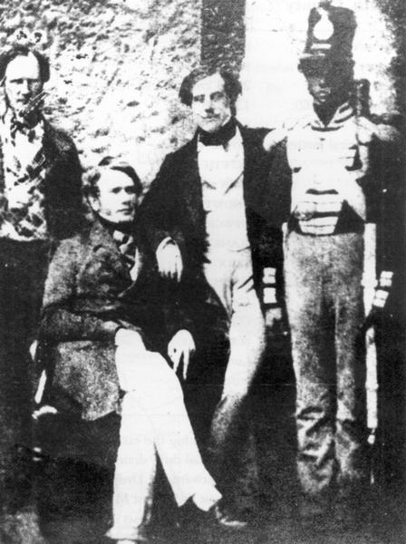 Thomas Francis Meagher, second from right, and William Smith O'Brien, seated, under guard at Kilmainham Gaol after the failed Young Irelander Rebellion of 1848
