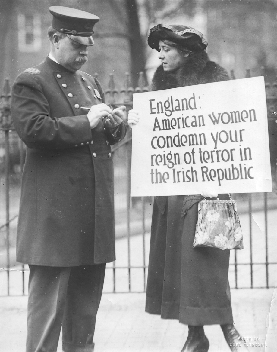 Irish-American activist Mae Manning receives a ticket during a protest outside the White House in 1920.
