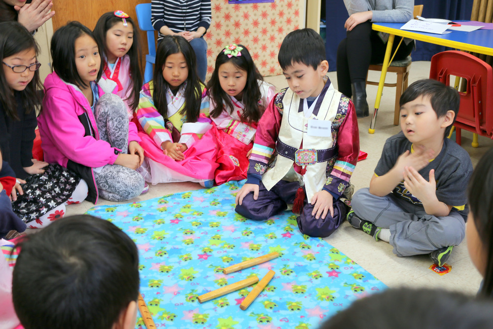 Learning Yut-Nori, a traditional New Year's Game, at Korean Culture School