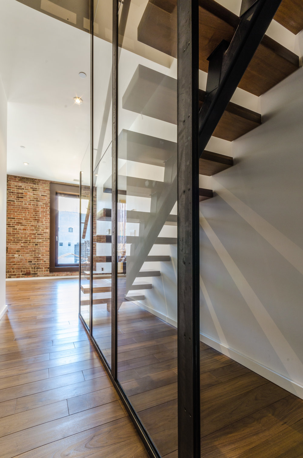 TRAstudio_173WestBroadway_Tribeca_4th Floor Interior_Stair_Glass_Looking Out.jpg