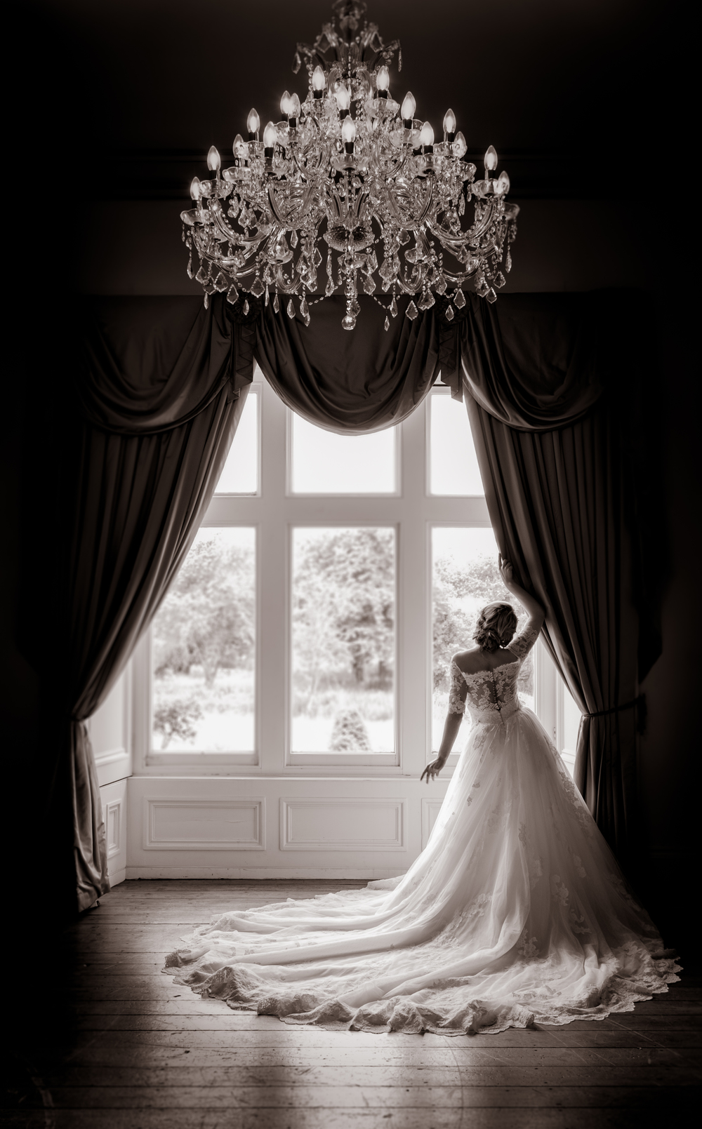 Simply stunning, Richards framing of the chandelier and Nicole's pose make this photo a work of art!