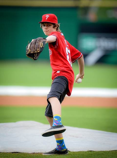 Ty Simpkins throws out the first pitch at a Phillies Spring Training game.