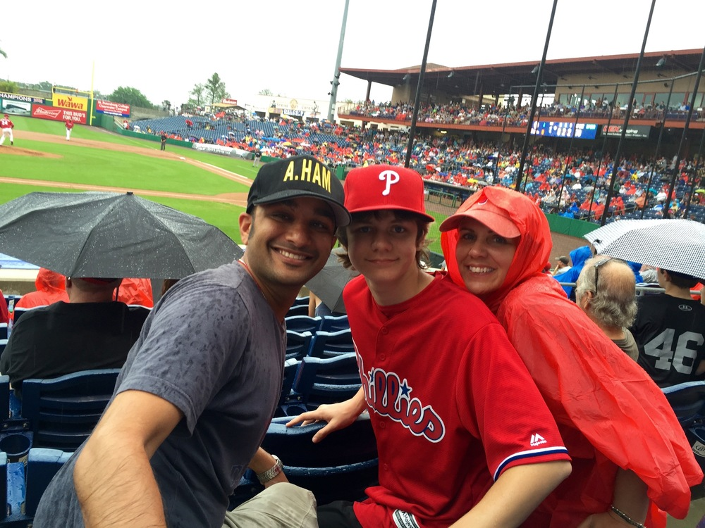 Ty, Muneesh and Monique enjoying a rain soaked Phillies game