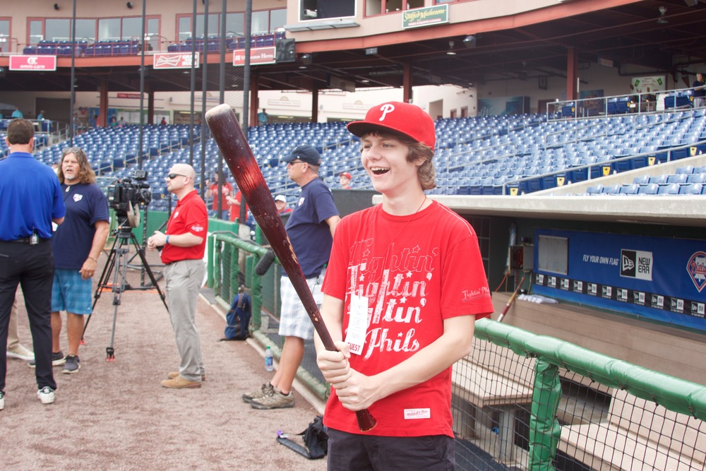 Ty holding Ryan Howard's bat