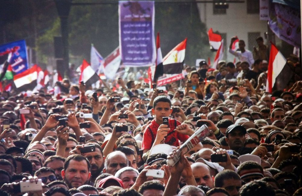 Protesters during a speech in Tahrir Square, April 8, 2011. Photo by Mosa'ab Elshamy. © Mosa'ab Elshamy. Shared courtesy of Lara Baladi.