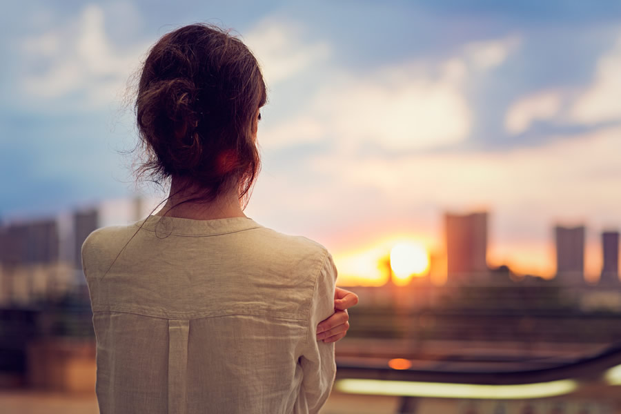 Young-Woman-Watching-Sunset-900.jpg