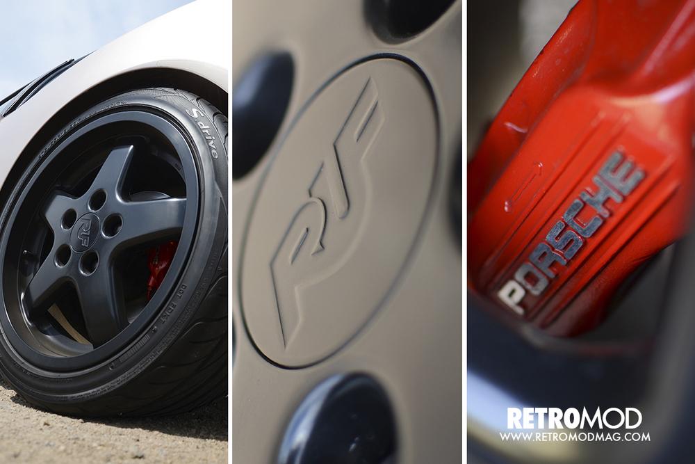 Ruf alloy wheels hide massive red Porsche calipers.
