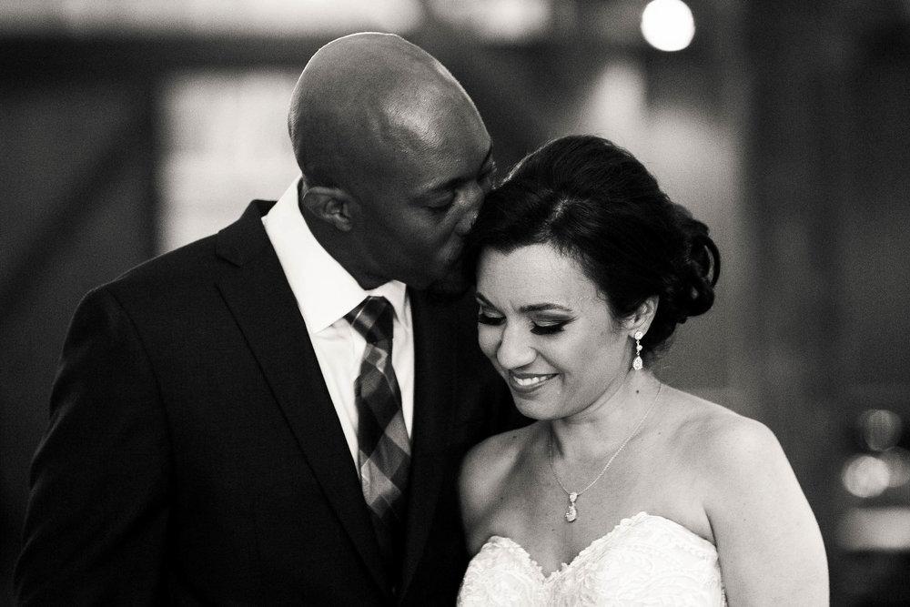groom-kissing-bride-forhead.jpg