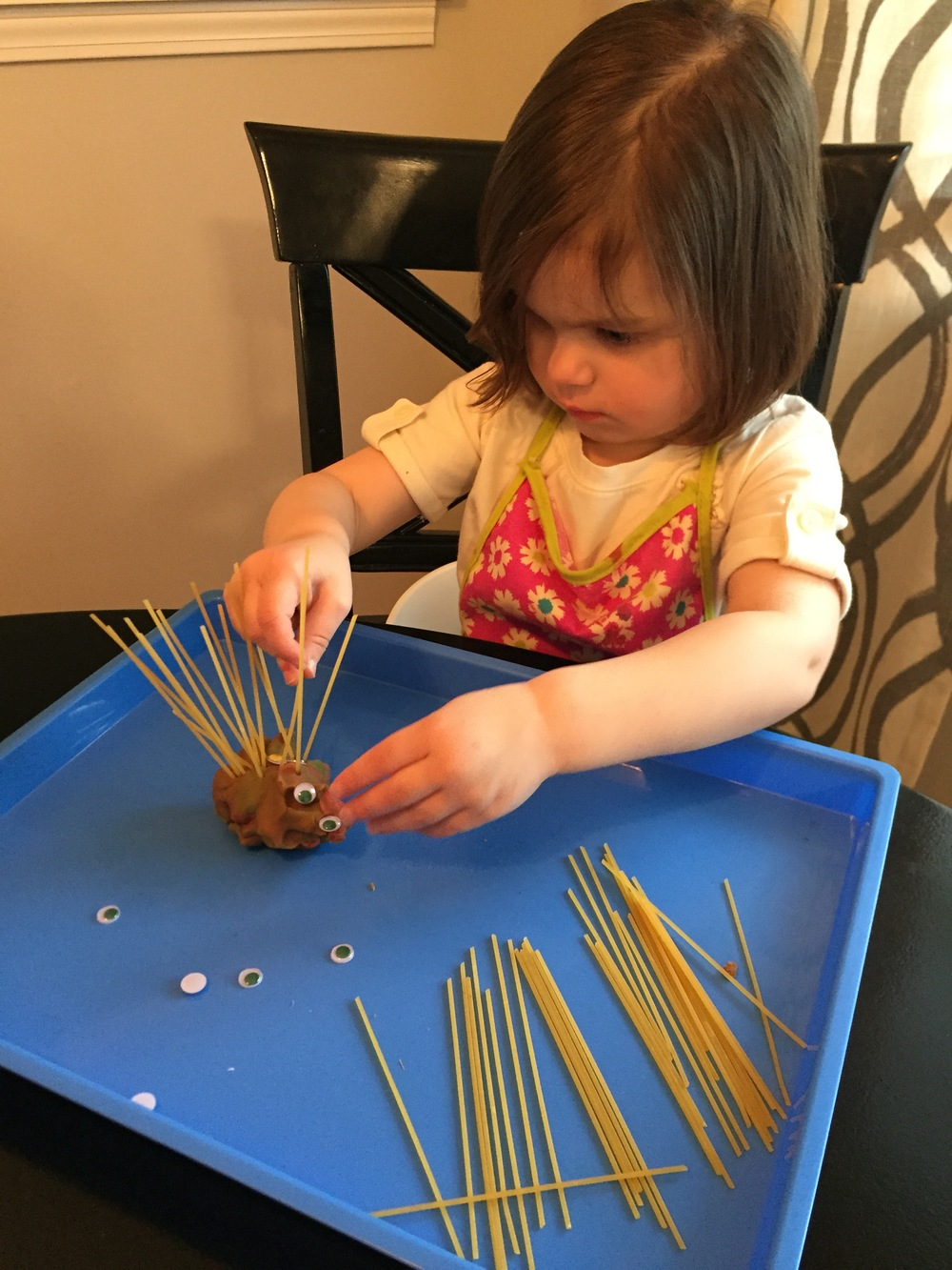Madeline working hard on her play dough porcupine.  We traded the toothpicks for spaghetti noodles today so that Baby Jack could get in on the fun.