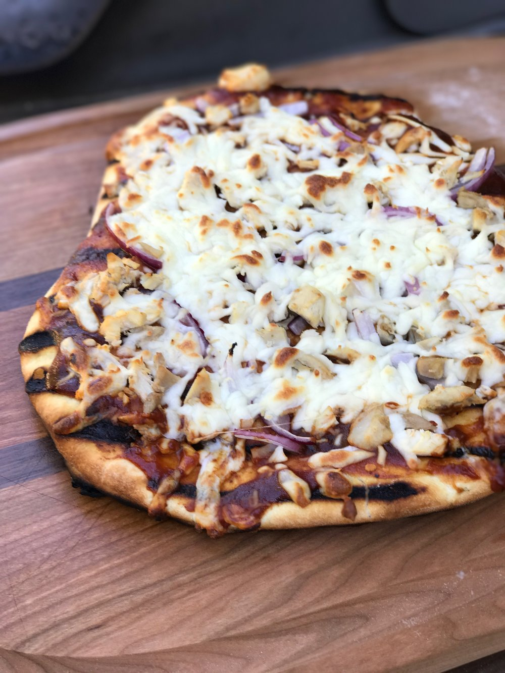 The first pizza was far from perfect, but still tasty. I topped it with Pendleton BBQ sauce, rotisserie chicken, red onions and mozzarella cheese.