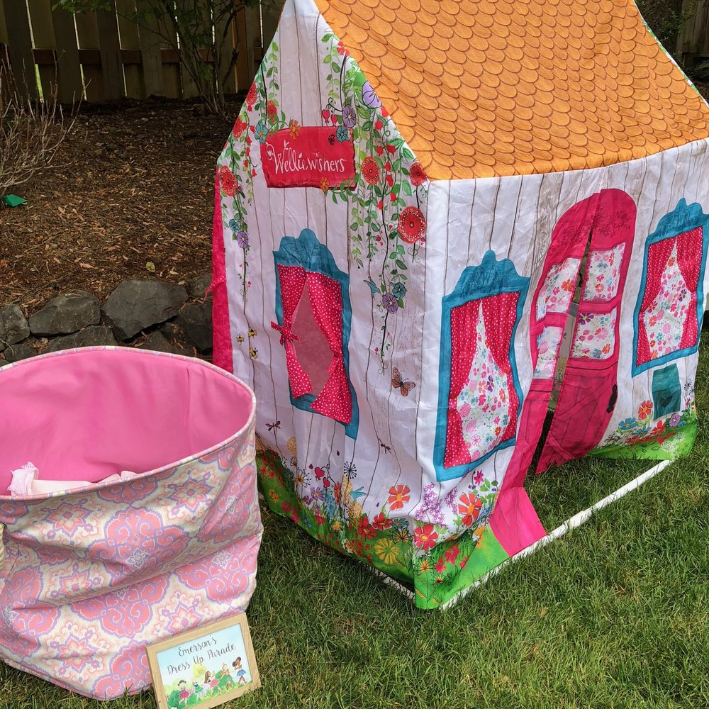 The birthday girl received this Wellie Wisher tent (that doubles as a theater on the back side!) as a Christmas gift. We repurposed her laundry basket to old dress up clothes - everything from butterfly wings to a pirate costume were found inside for pretend play and a parade.