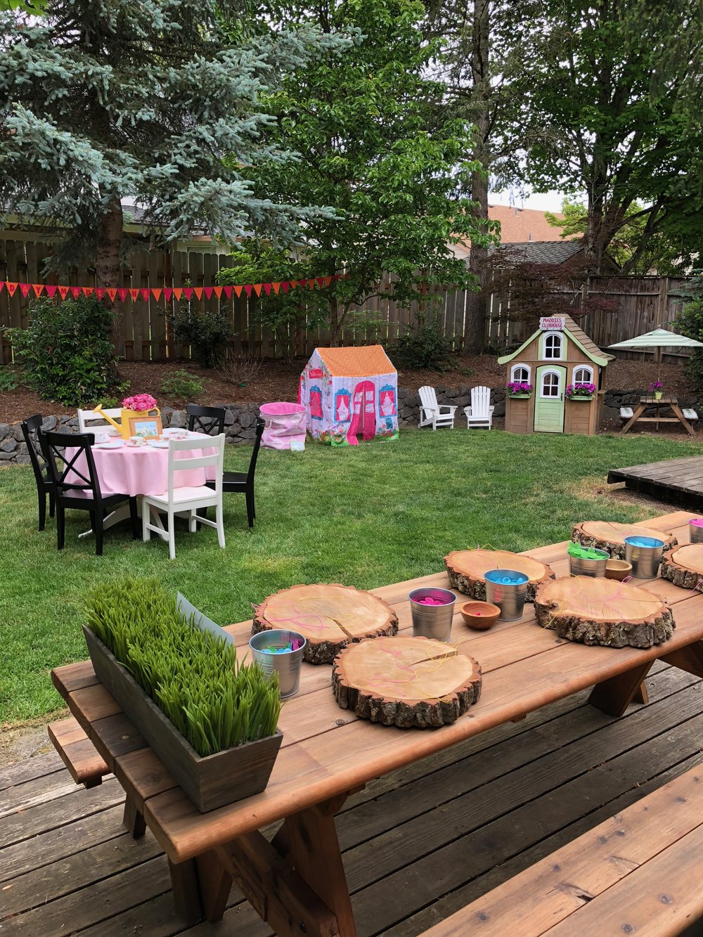 Our backyard isn't very large, but we had ample space for the five stations and plenty of room to move about. The banner in the trees is made of felt and was made by me for Maddie's first birthday party. I loved that it got some use again!