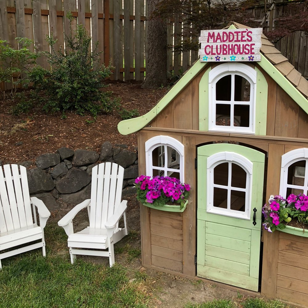 This playhouse and chairs are always in our back yard, but new flowers and the painted planked sign made it feel a part of the party's whimsey.