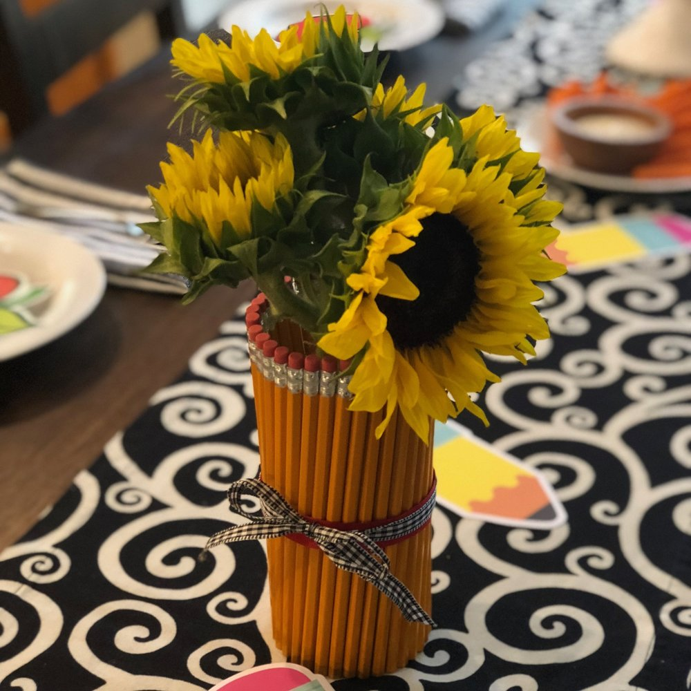 I held pencils around a glass with a rubber band then wrapped ribbon around the band. Though I plan to do this again year after year, I didn't want to store the vase or waste perfectly good #2 pencils!