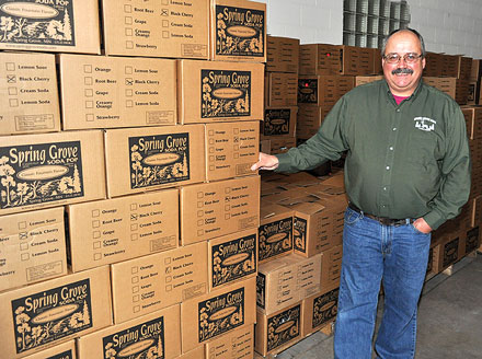 Spring Grove Soda Pop Vice President Bob Hansen with some cases all set to go. CRAIG MOORHEAD/SPRING GROVE HERALD