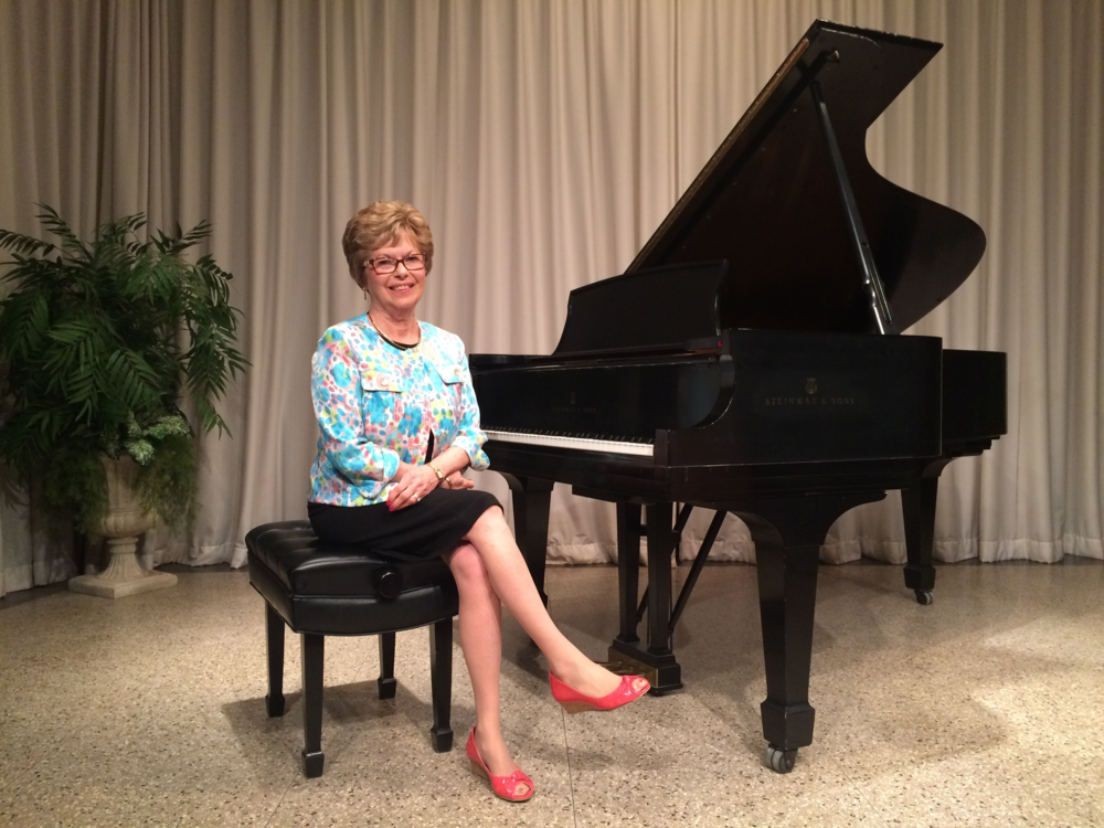 Mary Lou, on stage at Joslyn Art Museum, hosting our annual Spring Piano Recital