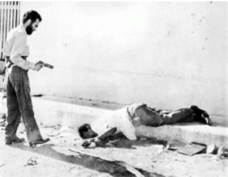 Executioner Rene Rodriguez Cruz shoots Garcia Olayon in the head,Jan. 2, 1959.