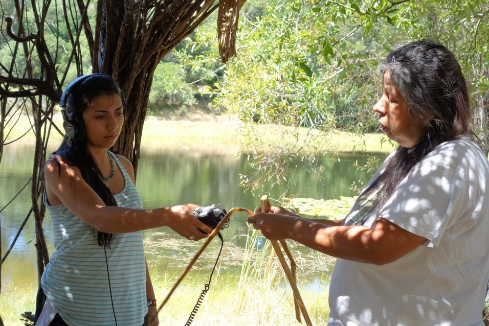 A young participant of one of our internships interviews a Native Californian Maidu elder about Tule reed weaving.