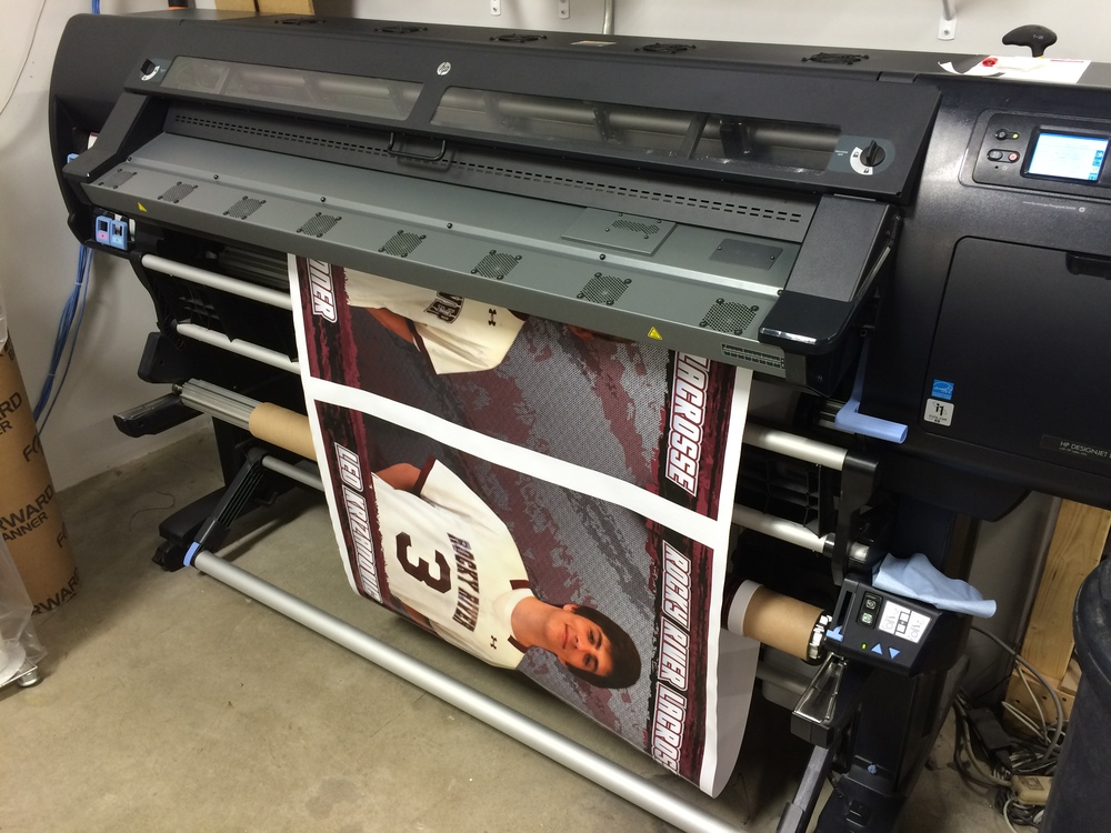 When printing wide format, we print on a roll rather than just a sheet.  The final images are then cut down for the finishing process.  Our machine can print on many different substrates.  In this case, it's a vinyl material that is great for both indoors and outdoors.