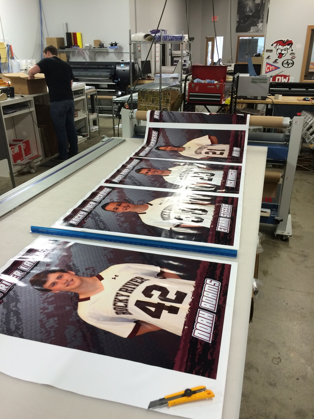 These banners are ready for cutting on our wide-format finishing table.