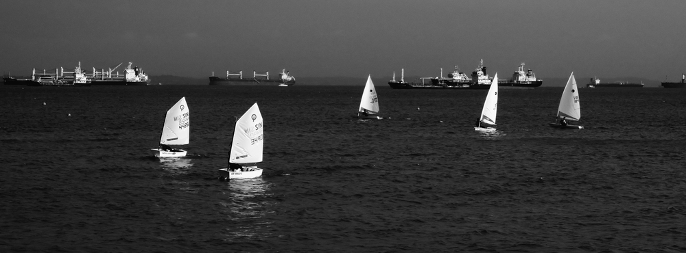 Converted to monochrome & cropped to pano, this was shot at the full 100mm extension with the boats a good kilometre or more away.  At full size the details of the ships on the horizon, the sailors and their yachts are all quite detailed, showing how much leeway the 20 megapixels gives you when cropping your images.