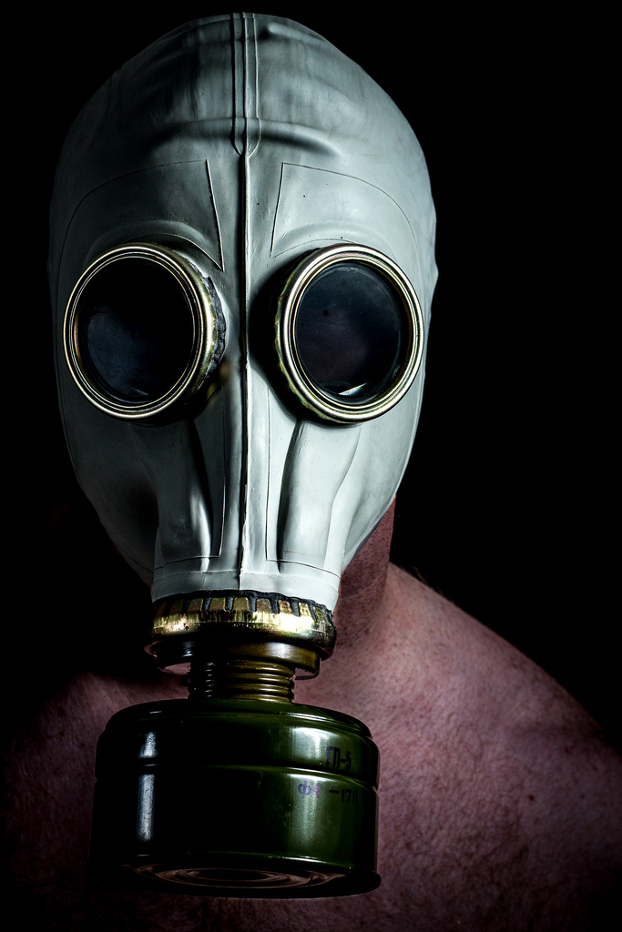 "Suffocated - I bought this gas mask from a Russian army surplus store.  I had a plan to try my hand at ""Urbex"" (urban exploration) and to shoot an atmospheric scene with this as a prop.  I didn't get round to the Urbex part but still wanted to use the gas mask.  As the project was nearing its end it was getting harder and harder to find inspiration for an image.  Suffocation seemed an apt name for this self portrait by that stage!"