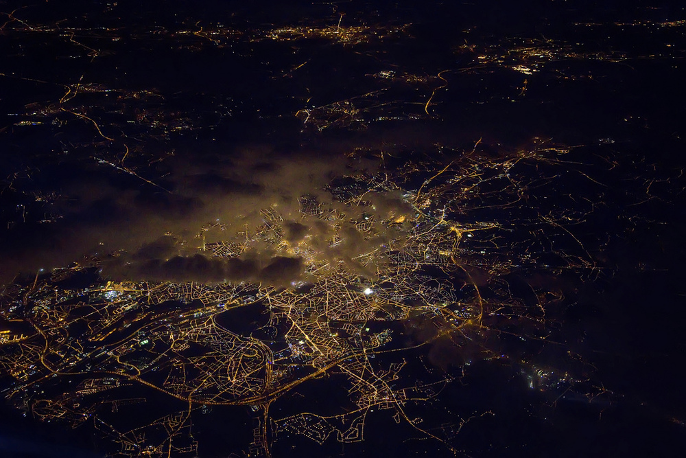 Bruges - I was surprised this came out so well, shot from a moving plane on a trip to Europe.  I like how the clouds are lit up, like seeing light pollution in reverse.