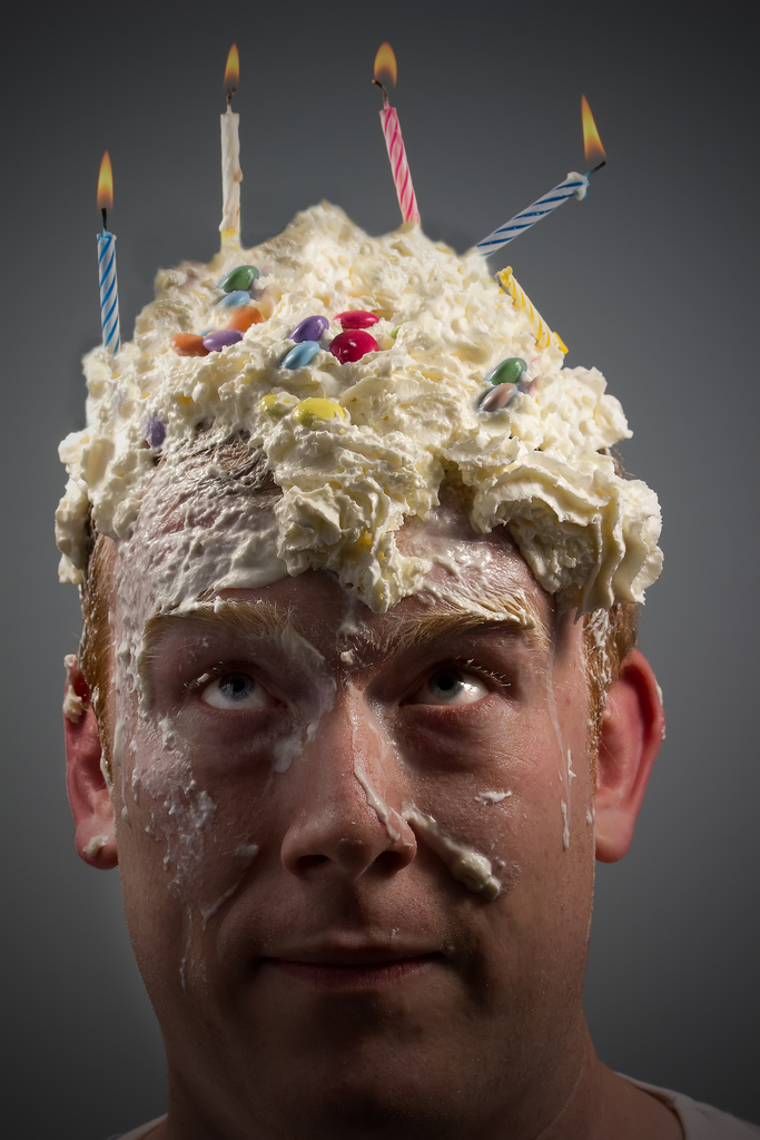 "I can't bake cakes... quite evident from this picture!  An odd self portrait I know but it was an entry into a competition themed around ""Celebration"".  The whipped cream took three washes to get the smell out of my hair..."