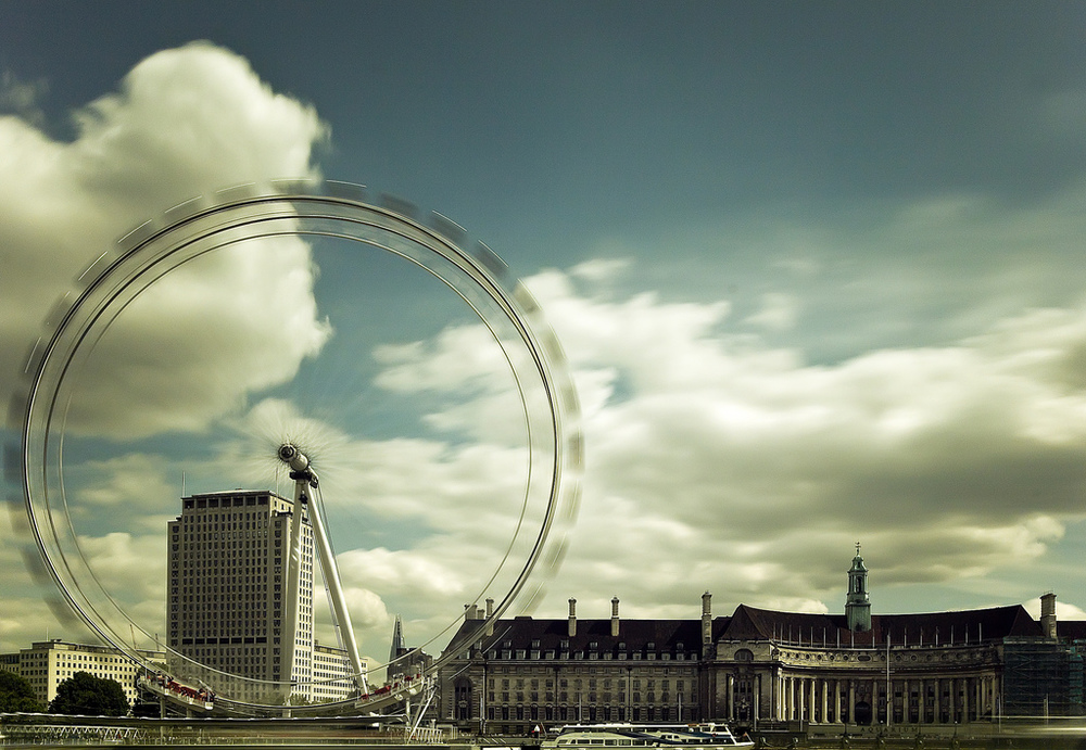 I used a homemade ND10 filter to freeze London's Millenium Eye.  With the greenish colour cast it reminded me of an old film look, even though this is essentially straight out of camera.