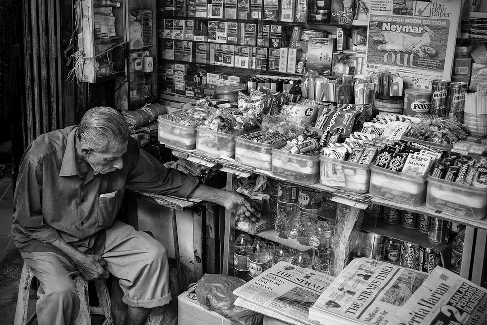 This was the very definition of a snap-shot!  Taken at 35mm and f/4, this shopkeeper was sat in a dark and cluttered alcove but the AF quickly locked on.  Minimal vignetting is visible at f/4 and good sharpness across the scene.    At 1/30th sec the VC has helped steady the shot but some motion blur is still visible in the shopkeeper's hand.  Remember all the lens stabilisation in the world won't stop your subject moving!