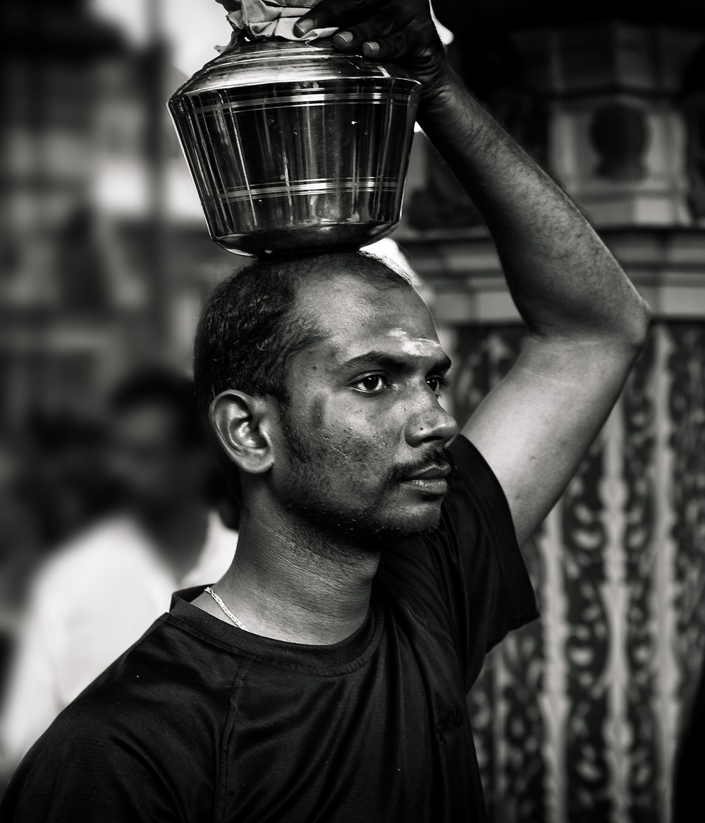 Even though the steel urn of milk is among the more modest of burdens, the determination and concentration on the faces of those undertaking the pilgrimage is plain to see.