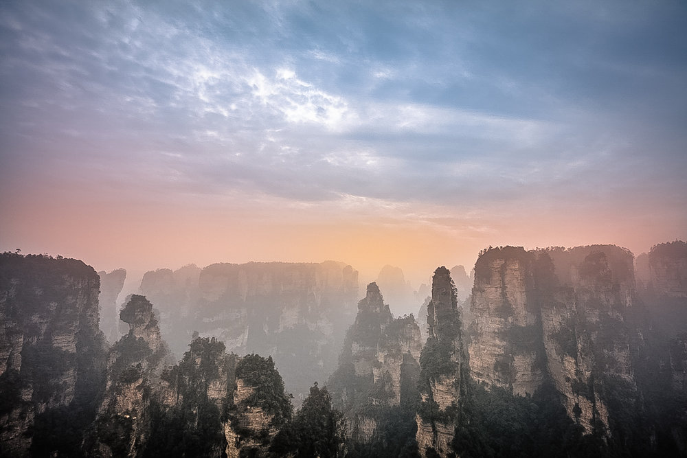 Pretty much my only photograph of Zhangjiajie with any kind of detail in the cloud. In reality the whole scene was bland, overcast whiteness. I think the sunset colour still looks fake here, albeit less so than my effort above, but it makes for a dramatic if unrealistic effect.