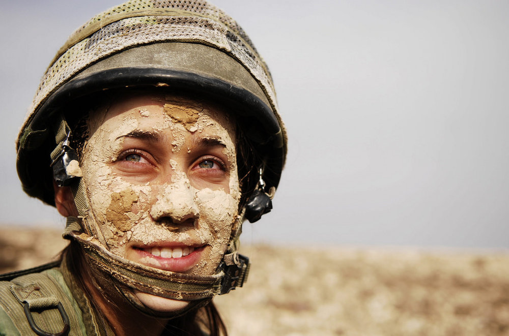 She looks exhausted, filthy but sort-of happy - and it makes the viewer want to know more.    Sadly I'm not entirely sure where this image is from - I think it might be the Israeli Army but I can't find a source to link back to!