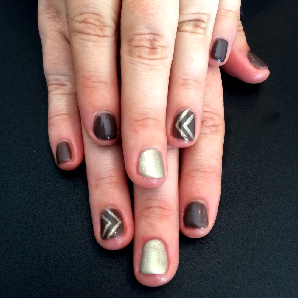 Gold chevron accent nail art