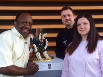 "Ashley Joslin & John Joslin along with Fox 8's Kenny Crumpton at CMA's 100th Celebration featuring Ashley's ""Tomb Guardian"" Cake."