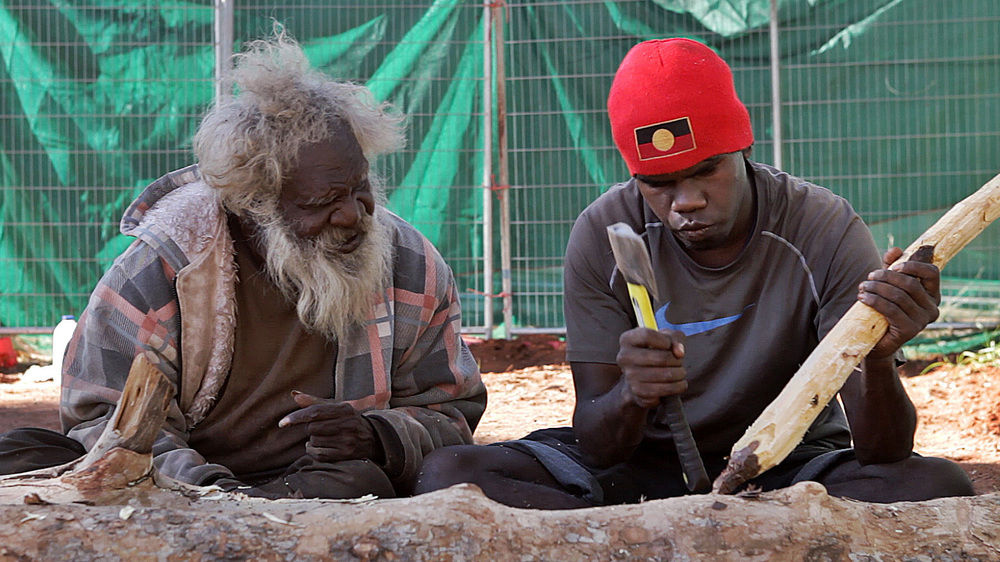 27 June, 2012 - Wirrimanu   Larry Gondura instructs a young Balgo man in traditional weapon making